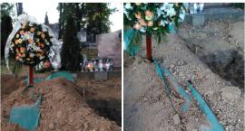 Jeden grób zasypany ziemią z drugiego, kwiaty zrzucone dalej. Dlaczego?