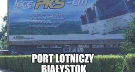 Bannery w pasach drogowych. Port lotniczy Białystok