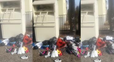 Ubrania zamiast w kontenerze, leżą na ziemi